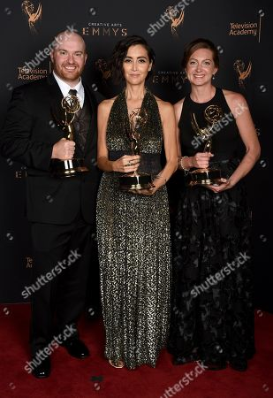 """Chase Paris, Carmen Cuba, Tara Feldstein Bennett. Chase Paris, from left, Carmen Cuba, and Tara Feldstein Bennett pose for a portrait with the award for outstanding casting for a drama series for """"Stranger Things"""" during night two of the Television Academy's 2017 Creative Arts Emmy Awards at the Microsoft Theater, in Los Angeles"""