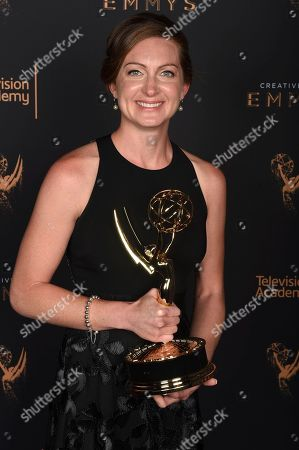 """Tara Feldstein Bennett poses for a portrait with the award for outstanding casting for a drama series for """"Stranger Things"""" during night two of the Television Academy's 2017 Creative Arts Emmy Awards at the Microsoft Theater, in Los Angeles"""