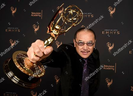 """James Lew poses for a portrait with the award for outstanding stunt coordination for a drama series, limited series or movie for """"Luke Cage"""" during night two of the Television Academy's 2017 Creative Arts Emmy Awards at the Microsoft Theater, in Los Angeles"""