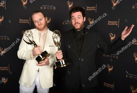 """Michael Stein, Kyle Dixon. Michael Stein, left, and Kyle Dixon pose for a portrait with the award for outstanding original main title theme music for """"Stranger Things"""" during night two of the Television Academy's 2017 Creative Arts Emmy Awards at the Microsoft Theater, in Los Angeles"""