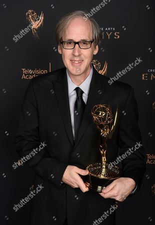 """Jeff Beal poses for a portrait with the award for outstanding music composition for a series (original dramatic score) for """"House of Cards"""" during night two of the Television Academy's 2017 Creative Arts Emmy Awards at the Microsoft Theater, in Los Angeles"""