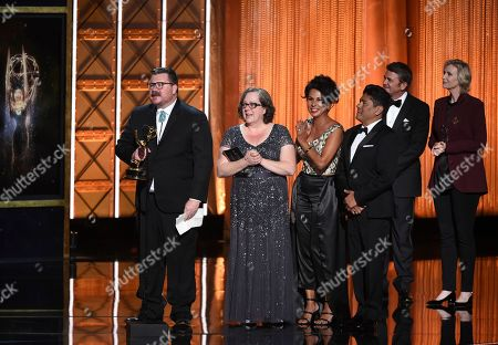 """Stock Image of Chris Clark, Helena Cepeda, Ralph Michael Abalos, Wendy Southard. Chris Clark, from left, Wendy Southward, Helena Cepeda, and Ralph Michael Abalos accept the award for outstanding hairstyling for a limited series or movie for """"Feud: Bette and Joan"""" during night two of the Television Academy's 2017 Creative Arts Emmy Awards at the Microsoft Theater, in Los Angeles"""