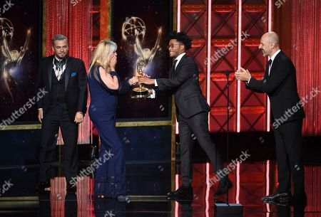 """Stock Picture of Donna Anderson, Bruce Samia, Pavy Olivarez, Joy Zapata. Donna Anderson, from left, Bruce Samia, Pavy Olivarez, and Joy Zapata accepts the award for outstanding hairstyling for a single-camera series for """"Westworld"""" during night two of the Television Academy's 2017 Creative Arts Emmy Awards at the Microsoft Theater, in Los Angeles"""