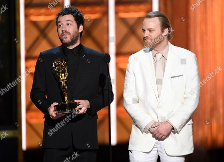"""Kyle Dixon, Michael Stein. Kyle Dixon, left, and Michael Stein accept the award for outstanding original main title theme music for """"Stranger Things"""" during night two of the Television Academy's 2017 Creative Arts Emmy Awards at the Microsoft Theater, in Los Angeles"""