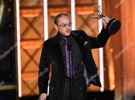 """James Lew accepts the award for outstanding stunt coordination for a drama series, limited series or movie for """"Marvel's Luke Cage"""" during night two of the Television Academy's 2017 Creative Arts Emmy Awards at the Microsoft Theater, in Los Angeles"""