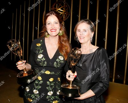 """Alex Friedberg, Susan Jacobs. Alex Friedberg, winner of the award for outstanding contemporary costumes for a series, limited series or movie for """"Big Little Lies"""", poses with Susan Jacobs, winner of the award for outstanding music supervision for """"Big Little Lies"""", at the Governors Ball during night two of the Television Academy's 2017 Creative Arts Emmy Awards at the Microsoft Theater, in Los Angeles"""