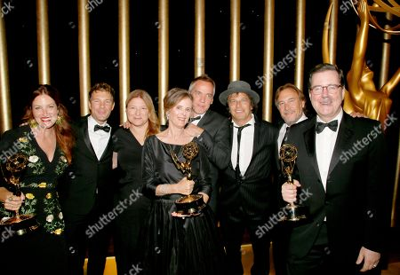 """Alex Friedberg, Susan Jacobs, David Rubin. Alex Friedberg, far left, winner of the award for outstanding contemporary costumes for a series, limited series or movie for """"Big Little Lies"""", poses with Susan Jacobs, center, winner of the award for outstanding music supervision for """"Big Little Lies"""", and David Rubin, far right, winner of the award for outstanding casting for a limited series, movie or special for """"Big Little Lies"""", at the Governors Ball during night two of the Television Academy's 2017 Creative Arts Emmy Awards at the Microsoft Theater, in Los Angeles"""