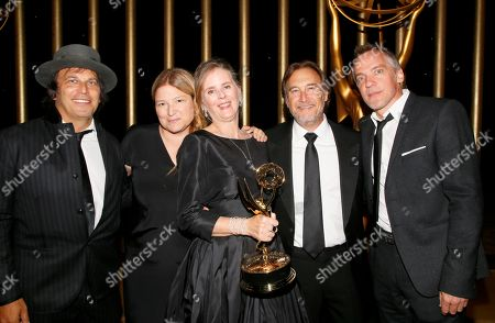 """Susan Jacobs poses with the award for outstanding music supervision for """"Big Little Lies"""" at the Governors Ball during night two of the Television Academy's 2017 Creative Arts Emmy Awards at the Microsoft Theater, in Los Angeles"""