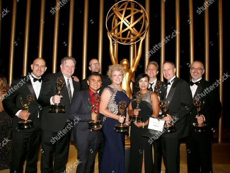 """Stock Picture of Thomas Mahoney, Randy Little, Sina San, Matthew Wheelon Hunt, Mark Anthony J. Nazal, Michael Capton, Ryan Bauer, Alex Gitler, Jon Anastasiades. The team from """"Gotham"""" pose with the award for outstanding special visual effects in a supporting role for """"Gotham"""" at the Governors Ball during night two of the Television Academy's 2017 Creative Arts Emmy Awards at the Microsoft Theater, in Los Angeles"""