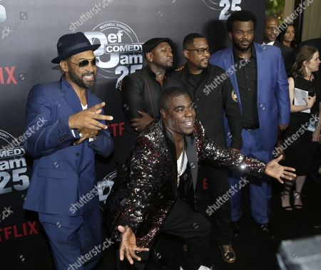 US comedian Tracy Morgan (C) and entertainers Joe Torry (2-L), Martin Lawrence (2-R), Craig Robinson (R) and Mike Epps (L) pose for photographers
