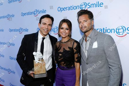 Dr Bill Dorfman, Brooke Burke-Charvet, David Charvet. From left, Dr Bill Dorfman, from left, poses with his Medical Visionary Award presented to him by Brooke Burke-Charvet and David Charvet at the Operation Smile 2017 LA Gala held at the The Broad Stage in Santa Monica, Calif