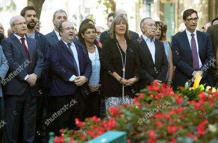Leader of the Catalonian Socialist Party (PSC), Miquel Iceta (2L), and former regional President Jose Montilla (L) attend the floral tribute at Rafael Casanova Monument on occasion of Diada Day, Catalonian National Day, in Barcelona, Spain, 11 September 2017. Rafael Casanova (1660-1743) is seen as an icon of Catalanism in reference to his role in the 1714 Siege of Barcelona. Large crowds are expected to hold rallies on Diada Day, related to a disputed regional independence referendum to be held in Catalonia in October.