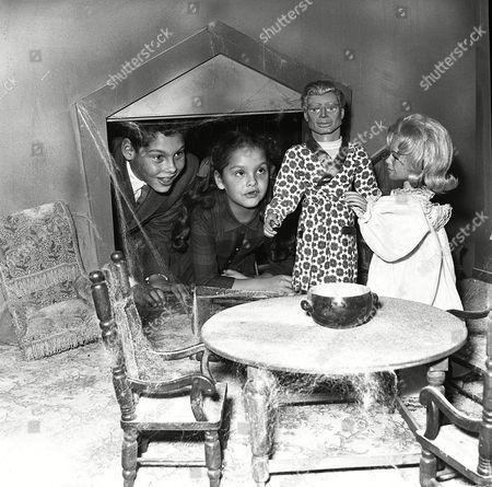 Bandleader Edmundo Ros and his children visit the Fireball XL5 set.