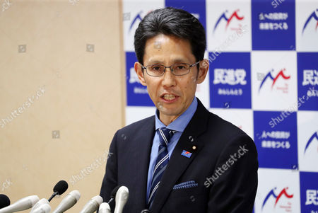 Japan's main opposition Democratic Party lawmaker Takashi Shina speaks at the party's lawmakers meeting