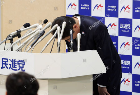 Japan's main opposition Democratic Party new president Seiji Maehara bows his head as he named the new executive members