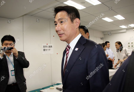 Japan's main opposition Democratic Party new president Seiji Maehara arrives at the party's lawmakers meeting
