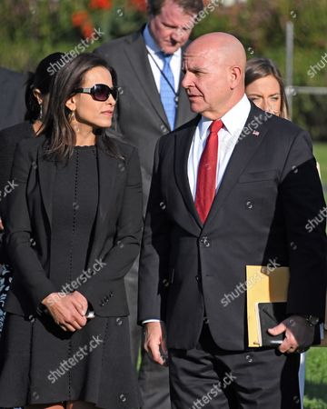 Deputy National Security Adviser for Strategy Dina Powell, left and National Security Advisor H.R. McMaster, right, await the arrival of the United States President and first lady who will lead a moment of silence in remembrance of those lost on September 11, 2001 on the South Lawn of the White House