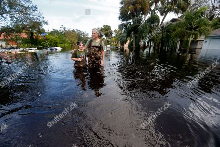 Kelly McClenthen returns to see the flood damage to her home with her boyfriend Daniel Harrison in the aftermath of Hurricane Irma in Bonita Springs, Fla