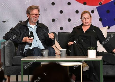 """Lili Fini Zanuck, Eric Clapton. Eric Clapton, left, and director Lili Fini Zanuck attend at a press conference for """"Eric Clapton: Life in 12 Bars"""" on day 5 of the Toronto International Film Festival at the TIFF Bell Lightbox, in Toronto"""