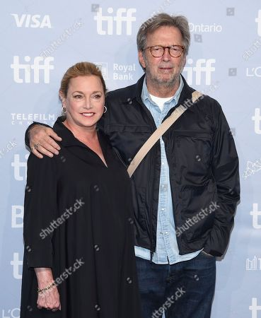 """Lili Fini Zanuck, Eric Clapton. Director Lili Fini Zanuck, left, and Eric Clapton attend a press conference for """"Eric Clapton: Life in 12 Bars"""" on day 5 of the Toronto International Film Festival at the TIFF Bell Lightbox, in Toronto"""