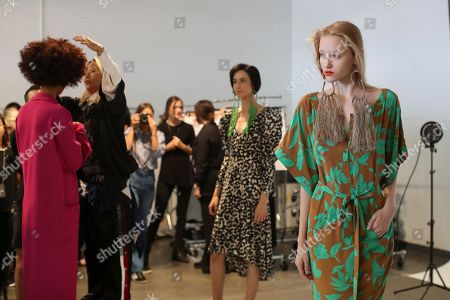 Models are seen backstage ahead of her Spring 2018 collection presentation during New York Fashion Week