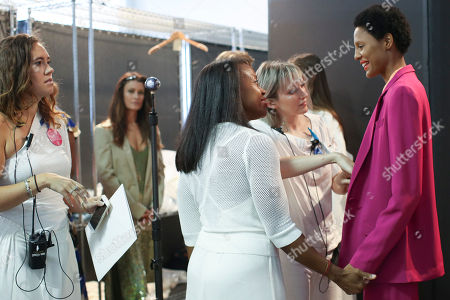 Designer Tracy Reese, center, helps style a model backstage ahead of her Spring 2018 collection presentation during New York Fashion Week