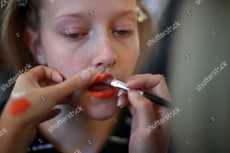 A model has her make up done backstage ahead of the Tracy Reese Spring 2018 presentation during New York Fashion Week