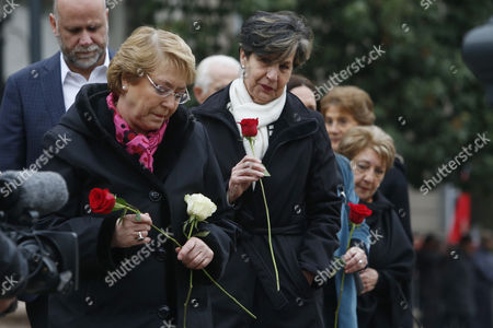 Chilean President Michelle Bachelet (L) and Isabel Allende (C), daughter of the late President Salvador Allende, participates in a tribute to the late president Salvador Allende and the victims of the dictatorship at on the occasion of the 44th anniversary of the coup at La Moneda Palace, in Santiago, Chile, 11 September 2017. The dictator Augusto Pinochet overthrew the government of Salvador Allende in a coup d?etat 44 years ago.