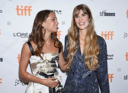 """Alicia Vikander, Lisa Langseth. Alicia Vikander, left, and director Lisa Langseth attend a premiere for """"Euphoria"""" on day 5 of the Toronto International Film Festival at the Winter Garden Theatre, in Toronto"""