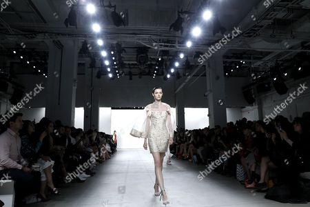 A model presents a creation by Lan Yu at the New York Fashion Week Spring 2018, in New York, New York, USA, 11 September 2017. The Spring 2018 collections are being presented from 07 to 13 September.