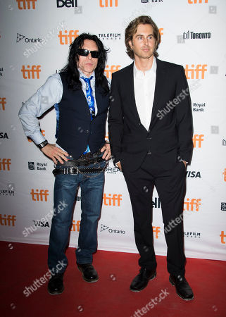 """Tommy Wiseau, Greg Sestero. Tommy Wiseau, left, and Greg Sestero attend a premiere for """"The Disaster Artist"""" on day 5 of the Toronto International Film Festival at the Ryerson Theatre, in Toronto"""