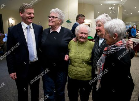 Prime Minister Bill English, left, poses for a photo with residents during a visit to a retirement village in Christchurch, New Zealand, . Advance voting began Monday, Sept. 11, 2017, for New Zealand's general election, which could see a change of government in the South Pacific nation for the first time in nine years
