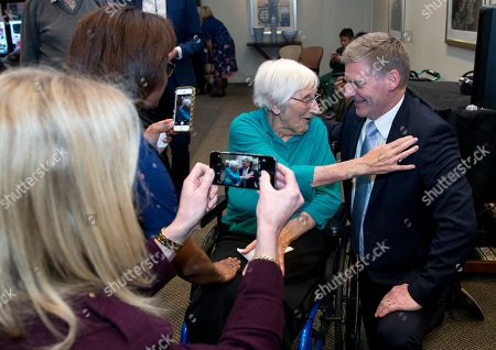Prime Minister Bill English poses for a photo with a resident during a visit to a retirement village in Christchurch, New Zealand, . Advance voting began Monday, Sept. 11, 2017 for New Zealand's general election, which could see a change of government in the South Pacific nation for the first time in nine years