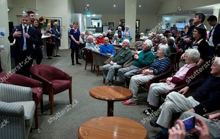 Prime Minister Bill English, left, addresses residents during a visit to a retirement village in Christchurch, New Zealand, . Advance voting began Monday, Sept. 11, 2017, for New Zealand's general election, which could see a change of government in the South Pacific nation for the first time in nine years