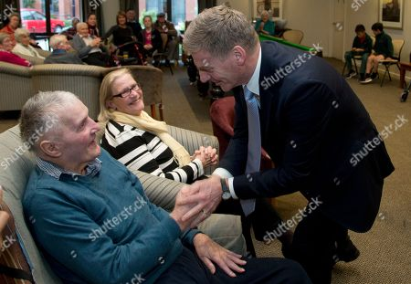 Prime Minister Bill English, right, greets residents during a visit to a retirement village in Christchurch, New Zealand, . Advance voting began Monday, Sept. 11, 2017, for New Zealand's general election, which could see a change of government in the South Pacific nation for the first time in nine years