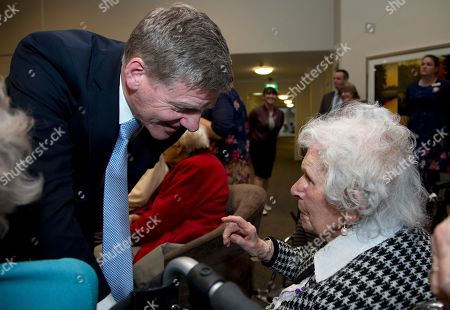 Prime Minister Bill English, left, greets residents during a visit to a retirement village in Christchurch, New Zealand, . Advance voting began Monday, Sept. 11, 2017, for New Zealand's general election, which could see a change of government in the South Pacific nation for the first time in nine years