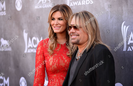 Rain Andreani, left and Vince Neil arrive at the 49th annual Academy of Country Music Awards at the MGM Grand Garden Arena, in Las Vegas
