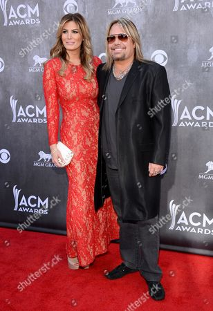 Rain Andreani, left, and Vince Neil arrive at the 49th annual Academy of Country Music Awards at the MGM Grand Garden Arena, in Las Vegas