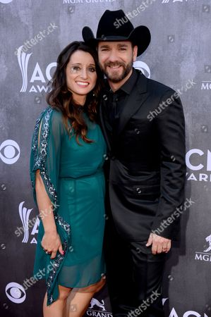 Mindy Ellis Campbell, left, and Craig Campbell arrive at the 49th annual Academy of Country Music Awards at the MGM Grand Garden Arena, in Las Vegas