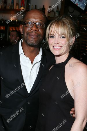 Lennie James, left, and Sprague Grayden attend the AMC, IFC, Sundance Channel Emmy After Party, on in West Hollywood, Calif