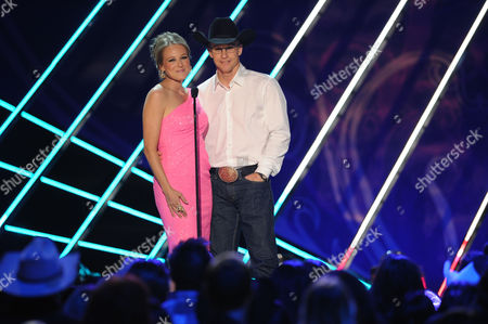 Stock Photo of Jewel and Ty Murray appear on stage during the American Country Awards, in Las Vegas