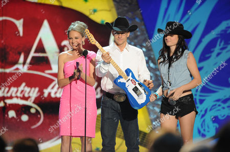 Jewel and Ty Murray appear on stage during the American Country Awards, in Las Vegas
