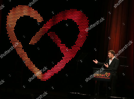 Ryan McGarry speaks onstage at the CoachArt Gala of Champions in Beverly Hills, Calif. on