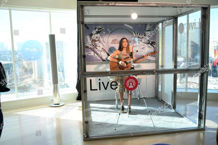 Camila Luna performs on a live stream inside the Mentions booth at the Facebook Mentions Lounge inside the MGM Skyloft suite on in Las Vegas