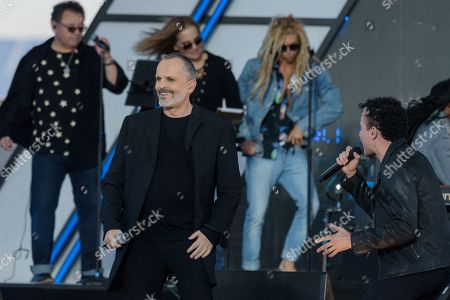 Miguel Bosé, left, and Juan Fernando Fonseca perform at RiseUp As One at Cross Border Xpress, in San Diego