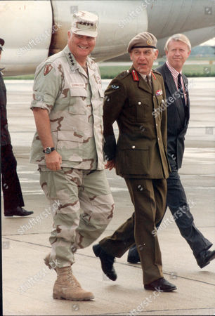 Gulf War Supreme Commander General Norman Schwarzkopf Is Met At Heathrow By British Army Commander General Sir Peter De La Billiere. Man On Right Is Robin Baxendale.