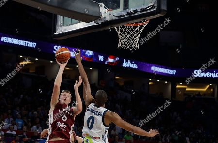 Latvia's Kristaps Porzingis, left, jumps to score a basket as Slovenia's Anthony Randolph tries to stop him during their Eurobasket European Basketball Championship quarterfinal match in Istanbul, Tuesday, Sept. 12. 2017