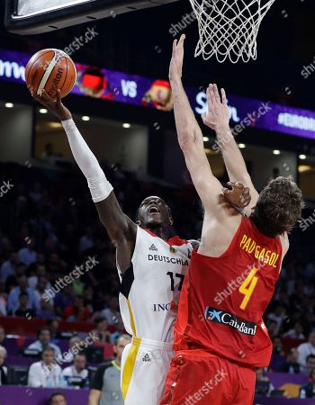 Germany's Dennis Schroder, left, jumps to score a basket as Spain's Pau Gasol tries to stop him during their Eurobasket European Basketball Championship quarterfinal match in Istanbul, Tuesday, Sept. 12. 2017