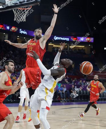 Germany's Dennis Schroder, right, tries to score as Spain's Marc Gasol blocks him during their Eurobasket European Basketball Championship quarterfinal match in Istanbul, Tuesday, Sept. 12. 2017