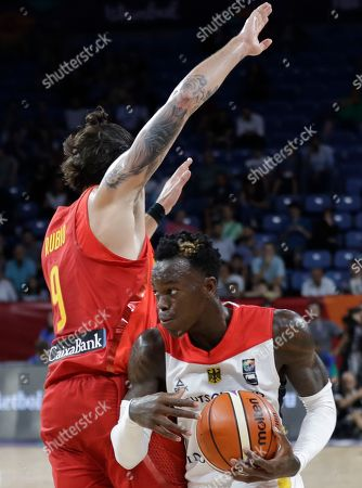 Germany's Dennis Schroder, right, drives to the basket as Spain's Ricky Rubio tries to block him during their Eurobasket European Basketball Championship quarter final match in Istanbul, Tuesday, Sept. 12. 2017